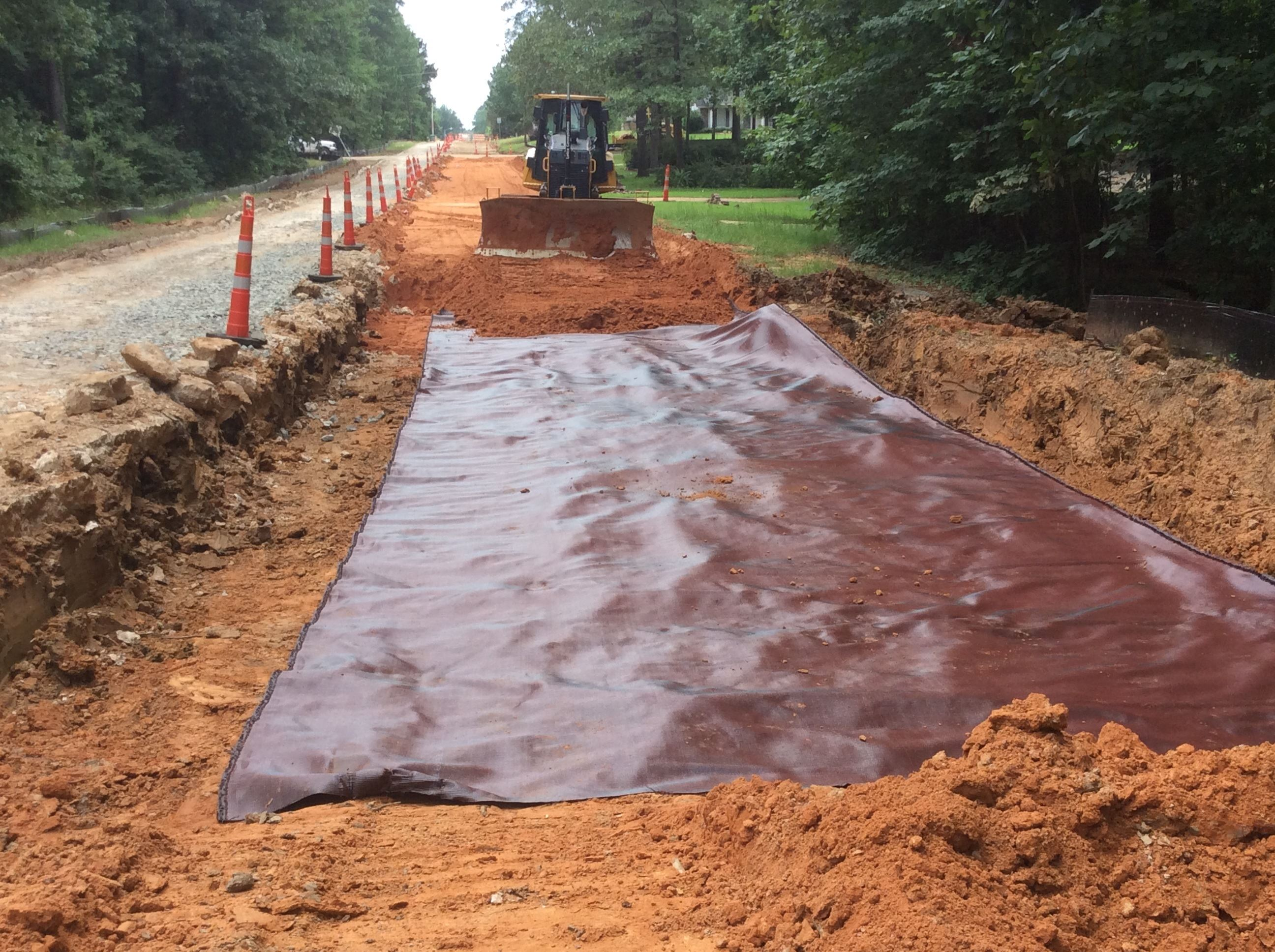 Forest Lake Estates reconstruction tarp on road